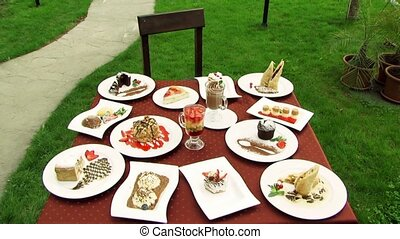 Table With Yummy - Many beautiful and delicious dishes are...