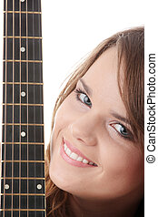 Young woman with black clasic guitar - Young woman covering...