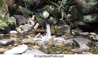 Water flowing from wooden pipe, fountain, waterplace - Clear...
