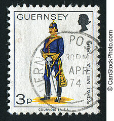 postmark - GUERNSEY - CIRCA 1974: The soldier in an ancient...