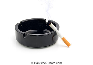 cigarette in a black ashtray - Smoking cigarette in a black...