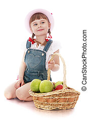 little girl with a basket of apples - Cheerful beautiful...
