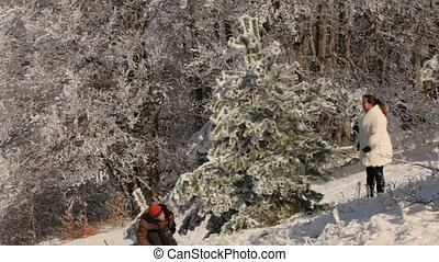 Family Plays A Snowball Fight - Young couple playing...