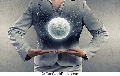 Full moon - Close up of businesswoman holding in hands full...