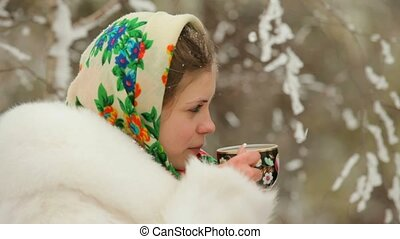 Girl Drinks Tea On A Cold - A beautiful young girl sitting...