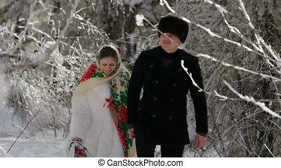 Young Couple Walking In The Woods