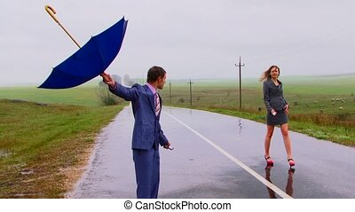 No Signal - There is a strong rain. Two joyful people try to...