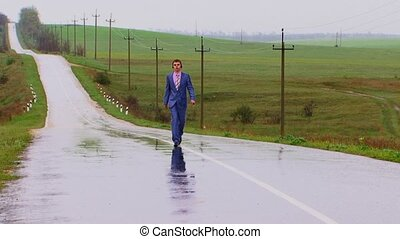 Rain Walking - There is a strong rain. The young man goes...