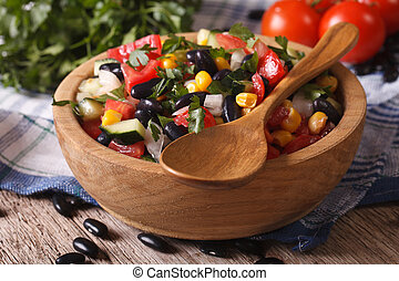 Mexican vegetable salad on plate closeup and ingredients...