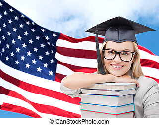 happy student girl with books over american flag -...