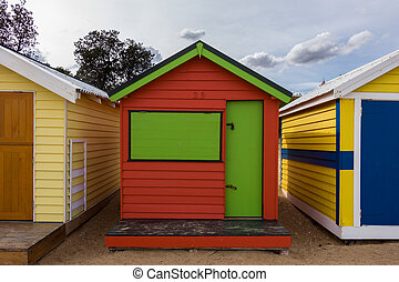 Bathing Boxes - Colourful bathing boxes on the beach, in...