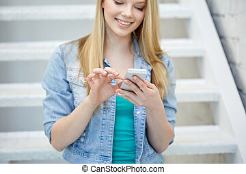 close up of female hands with smartphone