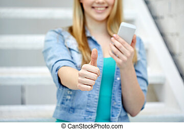 female with smartphone showing thumbs up - people,...