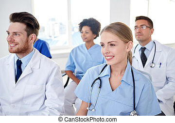 group of happy doctors on seminar at hospital - profession,...