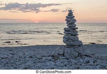 Rocks Piled on Each Other by ocean at sunset.