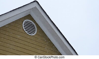Snow Falling on Eaves - Snowflakes fall in front of the roof...