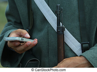 Historical re-enactment with a soldier and a smartphone -...