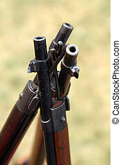 canes assault rifles standing close together - three canes...