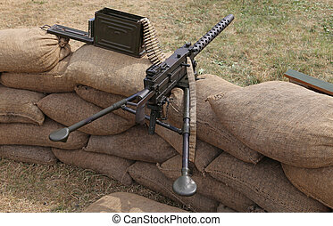machine gun with bullets in the trench war - big machine gun...