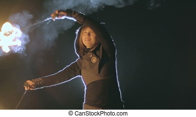 Skillful Fire Performer - Close up of fire juggler spinning...
