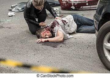 Dead man after car crash and prostrate driver