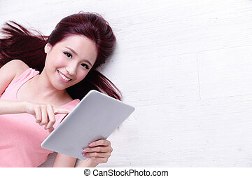 woman smile using tablet pc - Happy young beautiful woman...