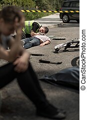 Road accident scene - Despair young driver at road accident...