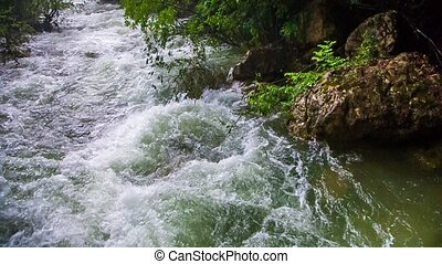 Rapid Water Of Mountain River Flowing Down - Pan shot of...