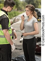 Scared driver talking with policeman at accident area