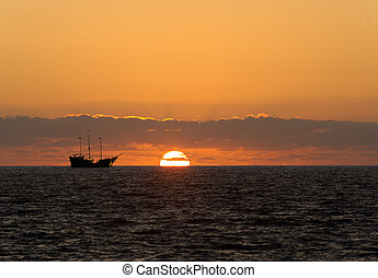 Pirate Ship Silhouette - Pirate ship sunset is sailing at...