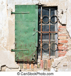 window shutter on an old house in the city of Lesce in...