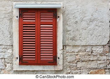 window shutter on an old house in the city of Pula in...