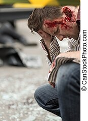 Bloody man after road accident - Image of bloody man after...