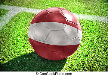 football ball with the national flag of latvia on the field...