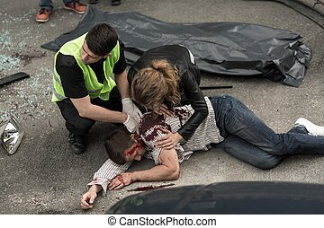 Human corpse on the street - Corpse of young man lying on...