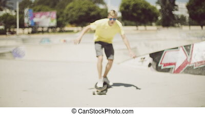 Young man enjoying a summer day skateboarding