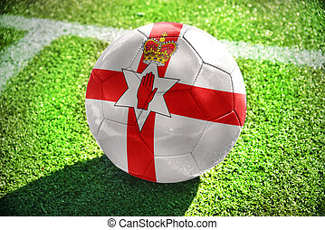 football ball with the national flag of northern ireland on...