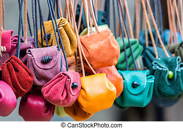 Many colorful moneybags in a row