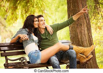 Romance On A Park Bench - Attractive young heterosexual...