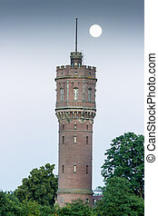 Water tower with full moon in evening - Water tower and...