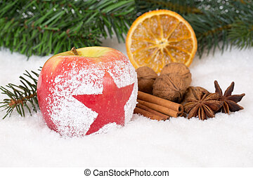 Winter apple fruit on Christmas decoration with snow and...