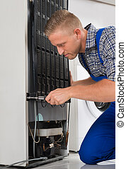 Worker Repairing Refrigerator In House - Male Worker...