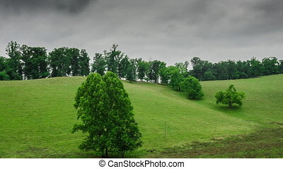 Clouds over Cow Pasture - A time lapse of gray storm clouds...