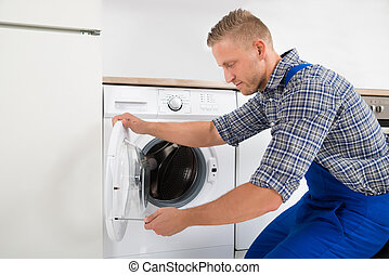 Technician Fixing Washing Machine - Young Male Technician In...