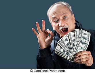 Happy elderly with fan of money