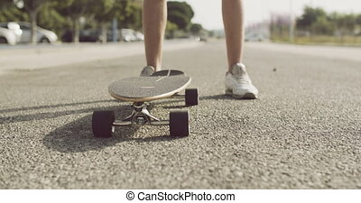 Boy standing with his skateboard