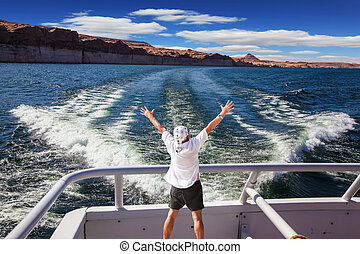 Man in white shirt on boat