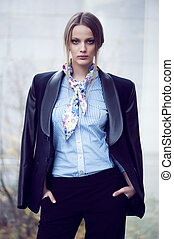 Fashion girl in blue blouse and black suit - Fashion girl in...