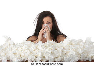 Girl with flue - Young woman in lot of tissues around, ill,...