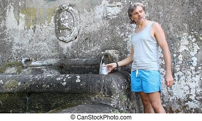man filling a bottle